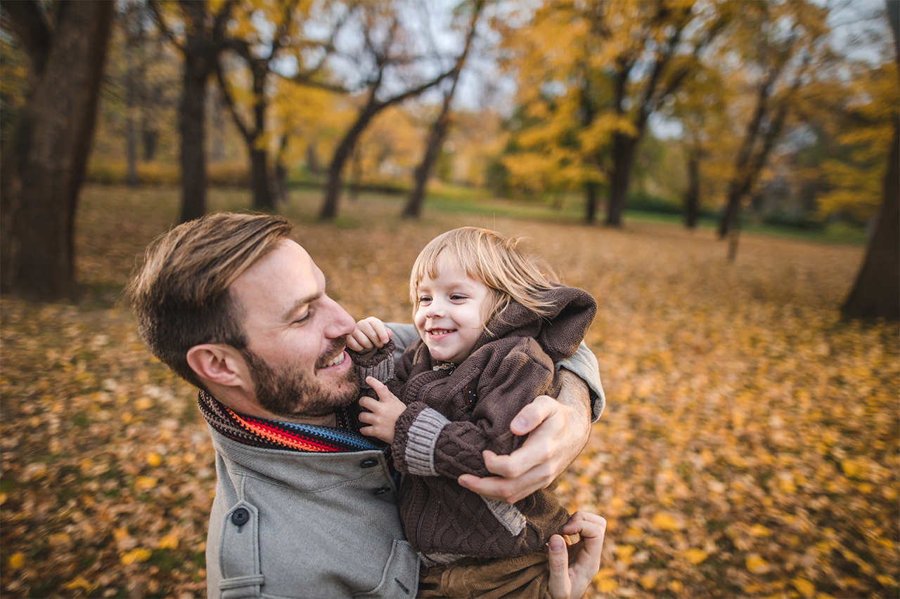 Father and child enjoying a fall day outdoors
