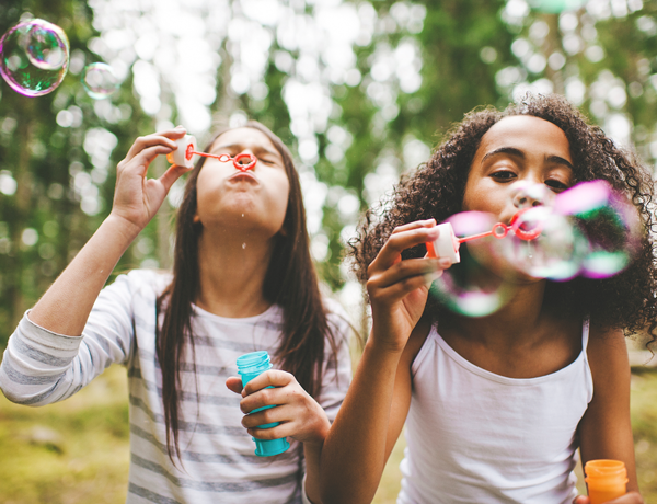 Young girls blowing bubbles